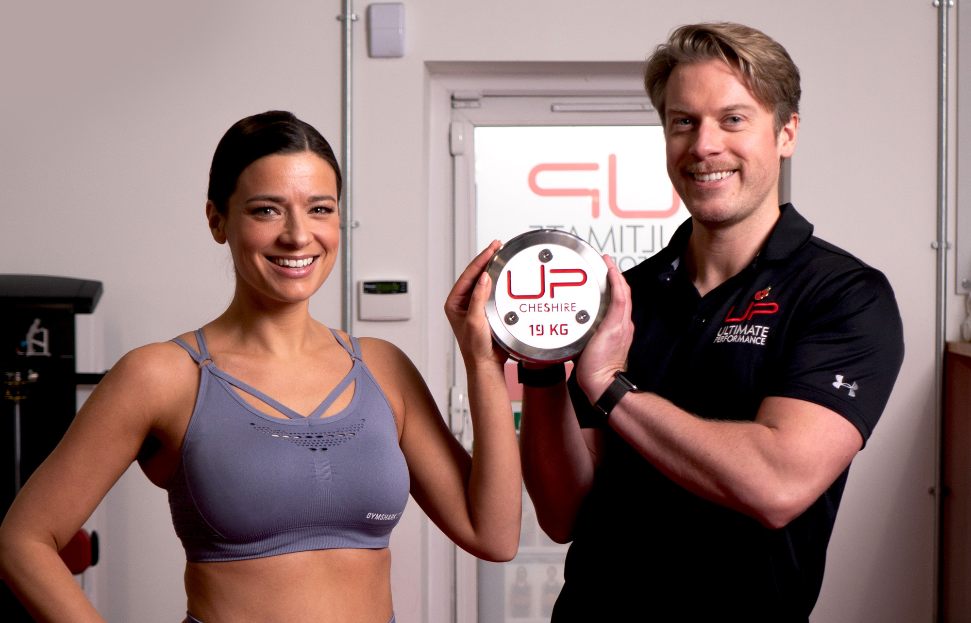 Sophie Austin posing with her U.P. trainer, Jimmy.